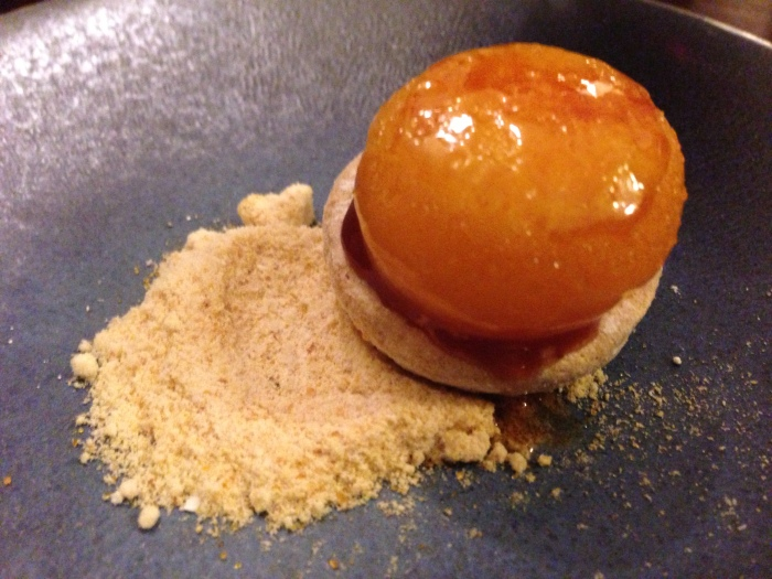 this was a bizarre dessert - it was like a shortbread cookie a layer of something and then a bruleed egg yolk ... when the egg yolk explodes in your mouth and then the salt and the sugar broke through