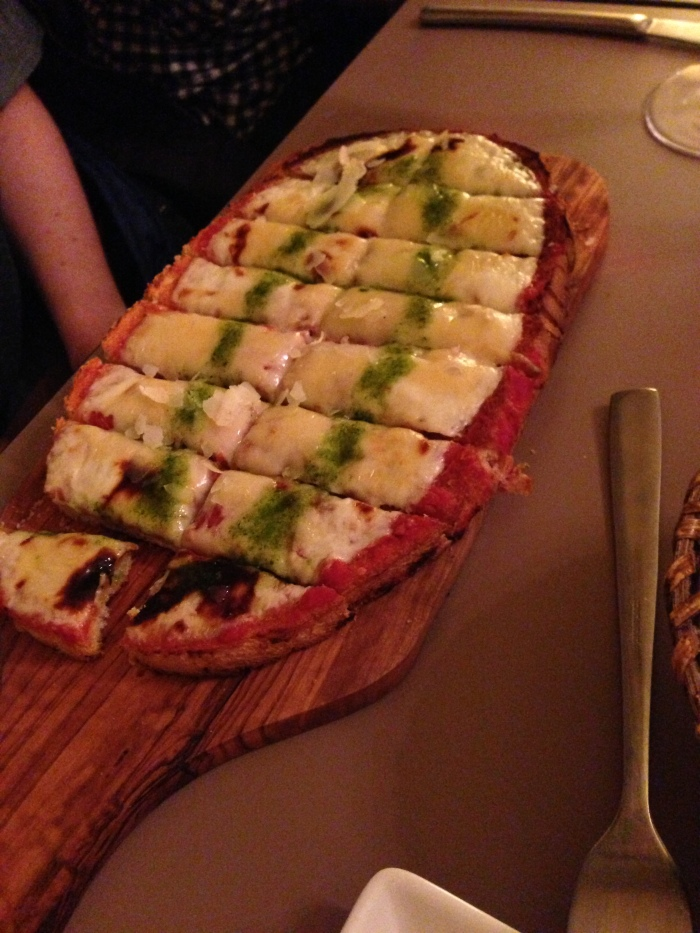 after shopping at a few stores, we ducked into a wine bar for food ... and while we thought we were ordering some kind of bruschetta - it ended up essentially being pizza!